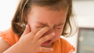 A child with ADHD cries over hurtful comments from a parent or a friend.