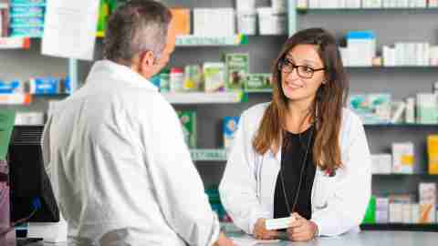 A pharmacist refills a prescription for ADHD medication for a patient
