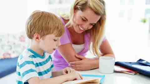 A mom with ADHD helps her son with his homework.