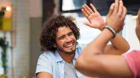 Man gives a high-five after realizing it's never too late to be what you might have been.