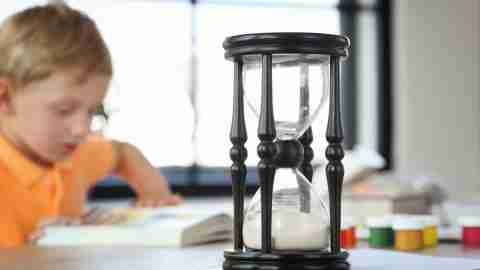 An hourglass being used as a timer by a boy with ADHD who is learning how to study effectively