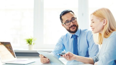 Business man with ADHD talking to colleague about ADHD accommodations at work