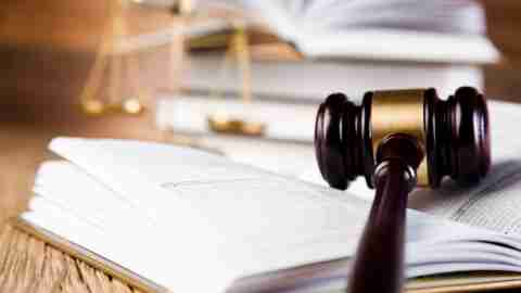 A gavel on a book, a symbol for the legal action a person with ADHD can take to get accommodations at work.