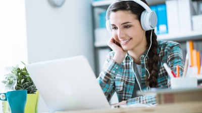 A woman uses music as a fidget to improve her focus and help her study.