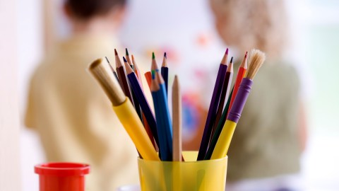 A cup of colored pencils a child with ADHD can use as a fidget to stay focused in class
