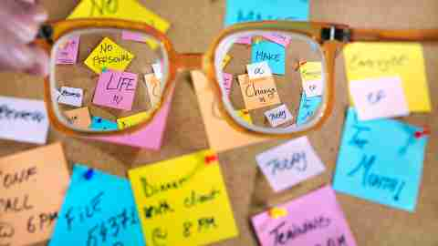 Glasses magnify the view of a bulletin board, in the same way ADHD can magnify certain emotions.