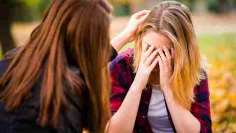 Girl talks with upset friend about her guilt and negative thoughts.