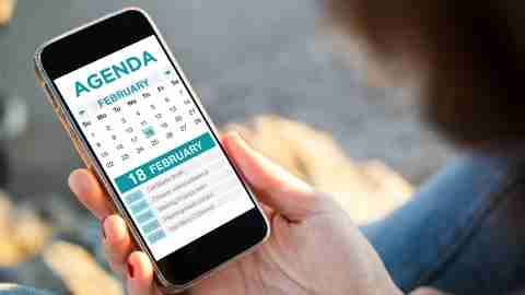 An adult with ADHD uses the calendar on their smart phone to break projects into smaller tasks.