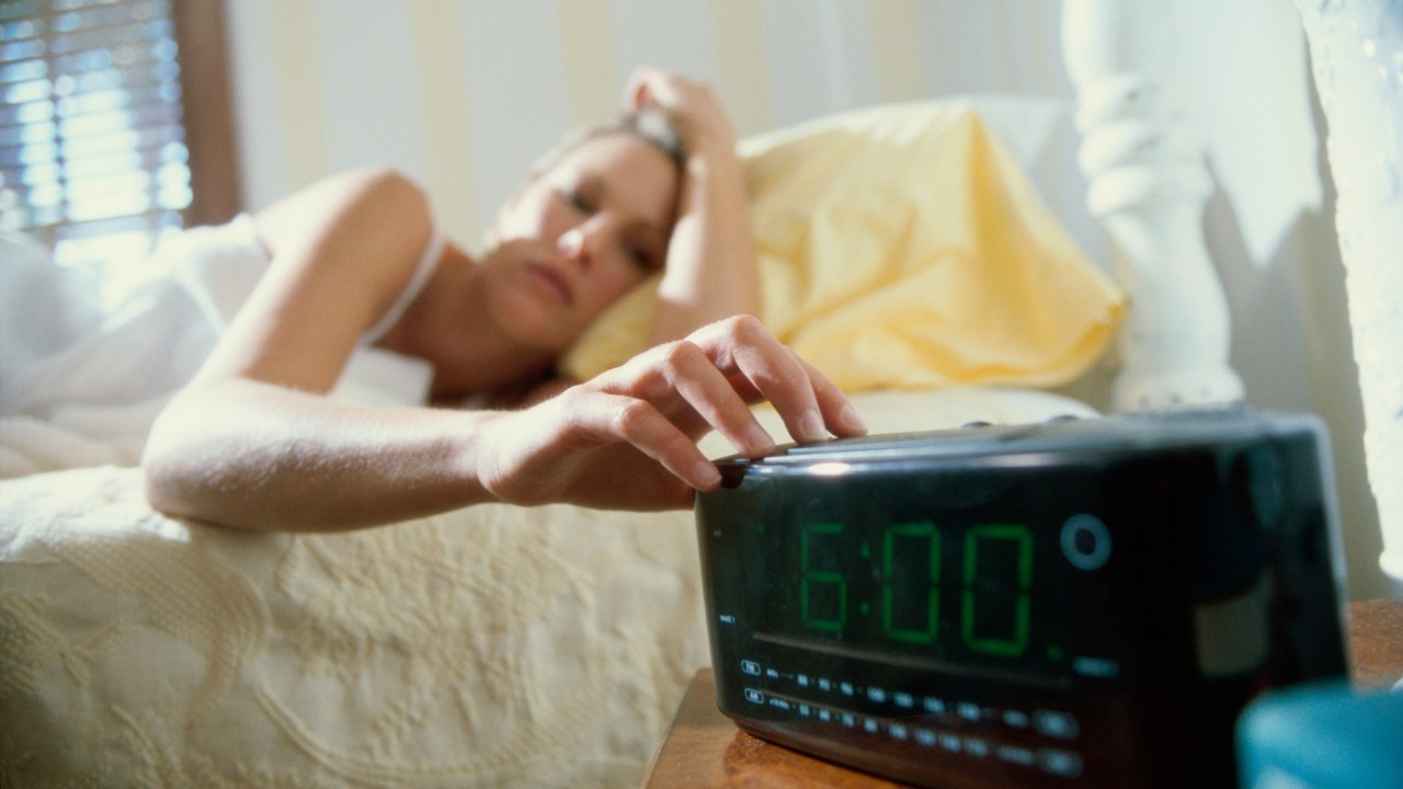 A woman who couldn't sleep hits snooze on her alarm