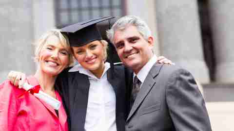 Parents congratulate their child, who has ADHD, on her graduation day