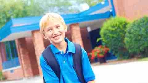 Smiling blond ADHD boy