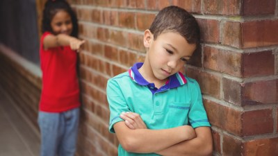 A boy with ADHD is made fun of by a classmate for under-developed social skills, a symptom formerly associated with Asperger's Syndrome.