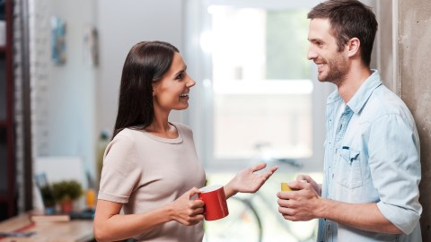 A man and woman discussing analysis paralysis