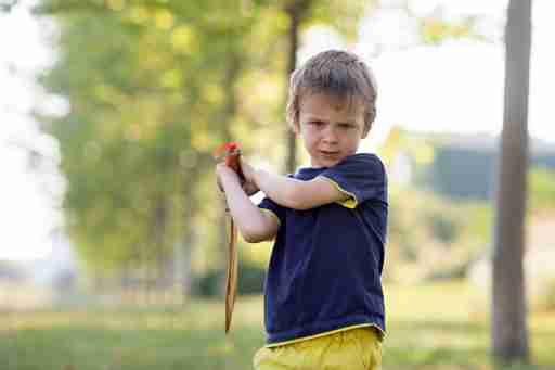 Oppositional Defiant Disorder (ODD) and ADHD plays with a toy sword.