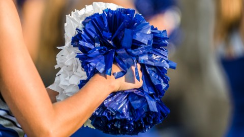 A cheerleader gives encouragement to a person who is ashamed of having ADHD.