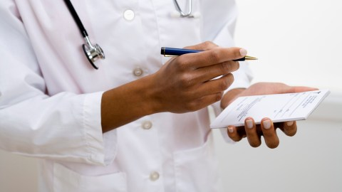 A doctor writes a prescription for the average dose of Adderall on her prescription pad