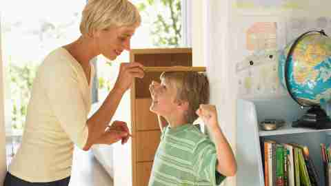 A mom measures her son's growth and progress.