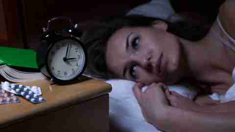A woman is suffering from insomnia caused by side effects of her ADHD medication.