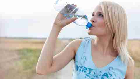 Woman drinking water. For some people with adhd, diet and nutrition are key components of managing their symptoms.