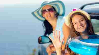 A mother and daughter at the beach, on a summer schedule