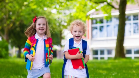 Young students with ADHD going to school with organized and color-coded school supplies