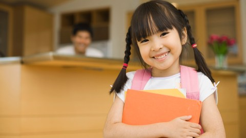 A girl with a well managed backpack, which is a good school organization idea.