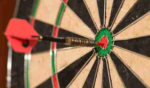 Dart on dartboard thrown by focused ADHD person.