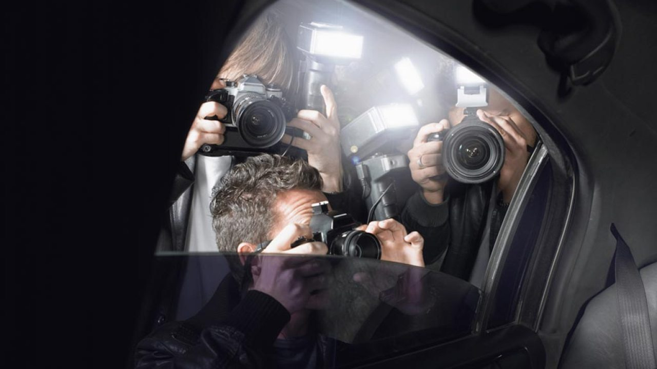 Paparazzi photographing a famous person with ADHD through limo window