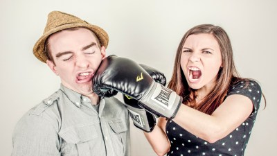 A woman hits a man with boxing gloves due to adult Oppositional Defiant Disorder symptoms