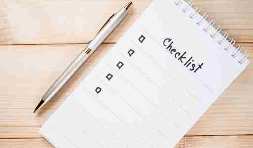 Notepad with checklist and pen, useful tools for helping people with ADHD get organized