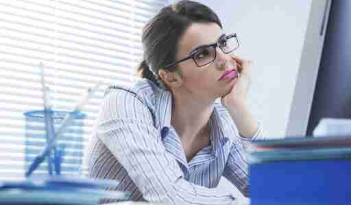 """A young woman with ADHD, sitting in front of a computer and thinking """"I am so bored at work!"""""""