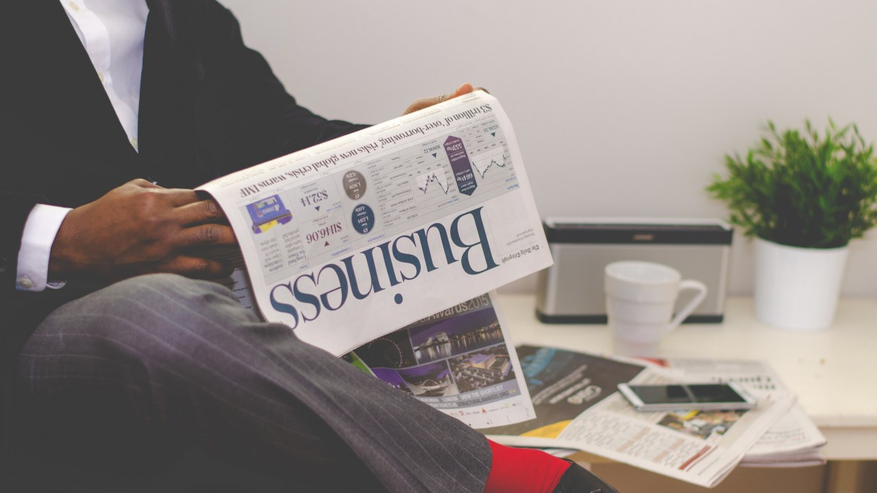 Early Career Success: Man Reading Business Publication