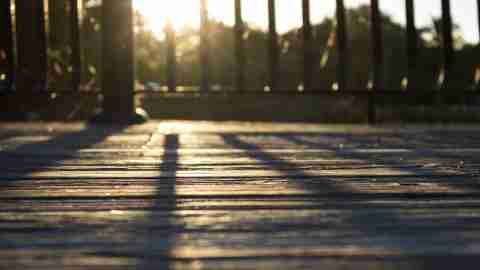 Sunlight & shadows across porch boards late in the day and stil procrastinating