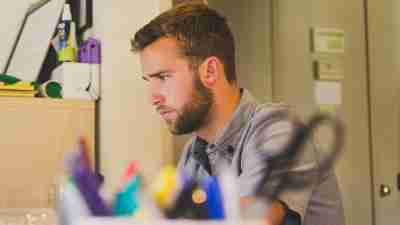 Hyperfocused man with ADHD at work while on computer