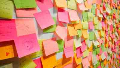 Wall covered in colorful Post-It reminders for an adult with ADHD