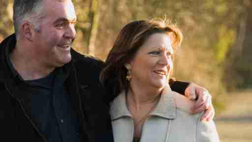 Happy couple strolling outside