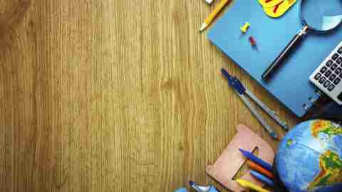 School supplies on wooden table belonging to ADHD student