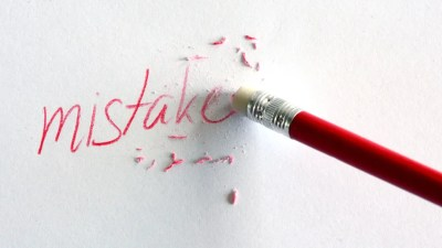 "Pencil belonging to ADHD person erasing word ""mistake"" from paper."