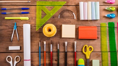 Wooden desk with school supplies neatly laid out belonging to ADHD student
