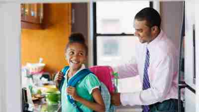 A father and daughter having a happy morning, getting ready for school