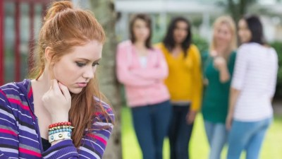 Teen girl with ADHD being bullied by group of high school kids