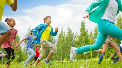 Children with ADHD running through field for exercise