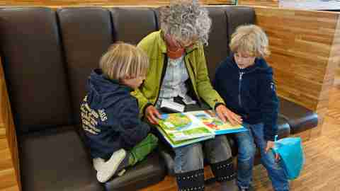 Mom reads story to two sons with ADHD in diner