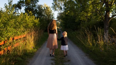 Mother and daughter with ADHD walk down country road