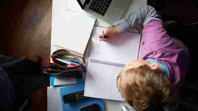 Boy with ADHD completing homework for school in a quiet place