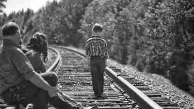 Family watches ADHD son walk down traintracks