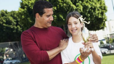 A father congratulating his daughter and learning how to praise a child with ADHD