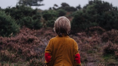 Boy with ADHD standing in front of hilltop