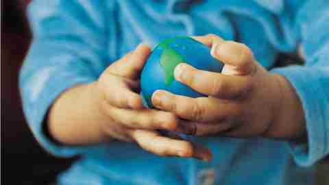 Child with ADHD holding toy globe