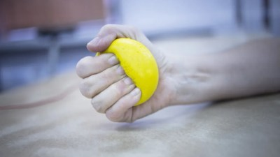 Hand of person with ADHD squeezing stress ball